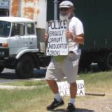 holding-police-scum-sign-233x300-160x160